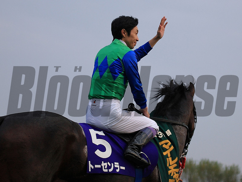 Yutaka Take became Japan's first jockey to win 100 grade or group I races! Tosen Ra wins the Mile Championship at Kyoto Racecourse, Japan.<br /> Naoji Inada Photo