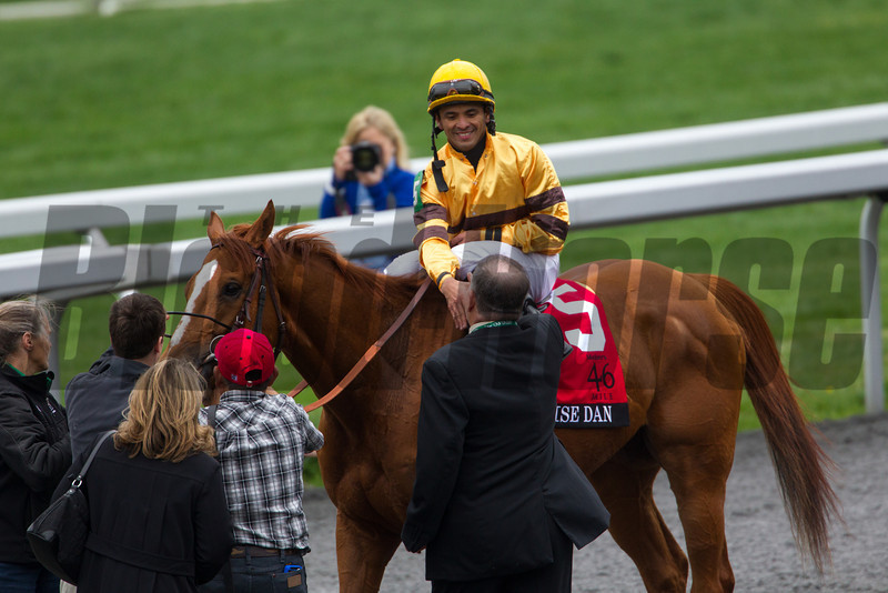 Jose Lezcano aboard Wise Dan, greets trainer Morton Fink after winning The 25th Running of The Maker's 46 Mile (Grade 1).  Photo by Mark Mahan