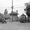 Santa Fe 584 eastbound crossing Rialto Ave and the Pacific Electric Railway I St Tower in San Bernardino circa 1948.<br /> <br /> Photographer James N Spencer <br /> Jeffrey Moreau Collection
