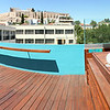 Deck with hot tub + view of the Acropolis at our hotel.
