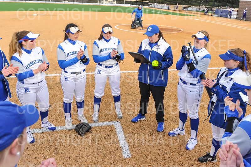 Hamilton College head coach Stephanie Hartquist, Team<br /> <br /> 3/14/19 5:03:06 PM Houghton College v Hamilton College, at Loop Road Softball/Baseball Complex, Hamilton College, Clinton, NY<br /> <br /> Final:  Houghton 2  Hamilton 10 (6 innings)<br /> <br /> Photo by Josh McKee