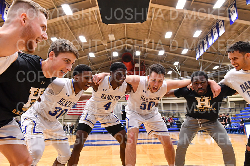 Team, Hamilton College guard Nkosi Cooper (30), Hamilton College guard Nick Osarenren (4), Hamilton College forward Mike McEneney (50)<br /> <br /> 11/20/19 8:32:48 PM Men's Basketball:  Bard College v Hamilton College at Margaret Bundy Scott Field House, Hamilton College, Clinton, NY<br /> <br /> Final:  Bard 57   Hamilton 101<br /> <br /> Photo by Josh McKee