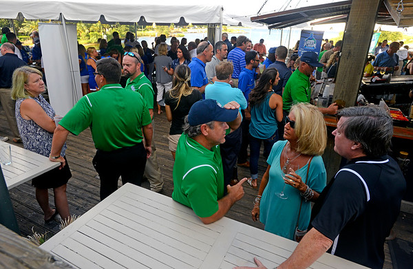 University of West Florida athletics fans mingle and socialize Thursday evening during the Argo Rally at The Fish House.