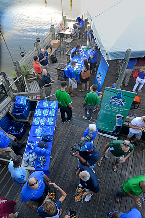 University of West Florida athletics fans mingle with UWF coaches Thursday evening during the Argo Rally at The Fish House.