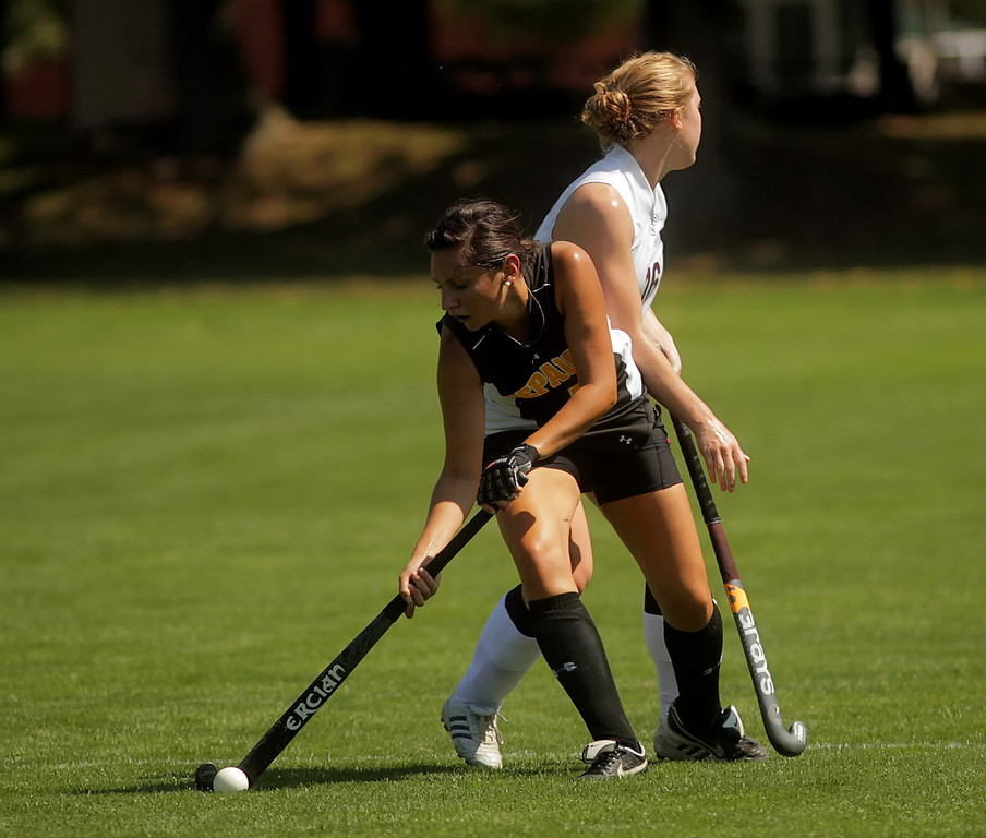 By Alex Turco/The DePauw-- Sophomore midfielder Sarah Maher moves the ball downfield during DePauw's game against Transylvania, Sept. 13, 2009 at McKeen Field.