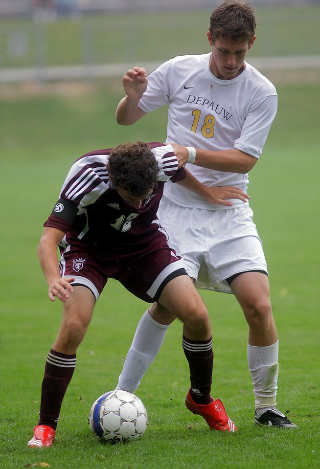 By Alex Turco/The DePauw--  Freshman forward Christopher Lee fights for control of the ball during DePauw's game against Alma, Sunday, Sept. 6, 2009. DePauw won a shut-out 3-0 victory.