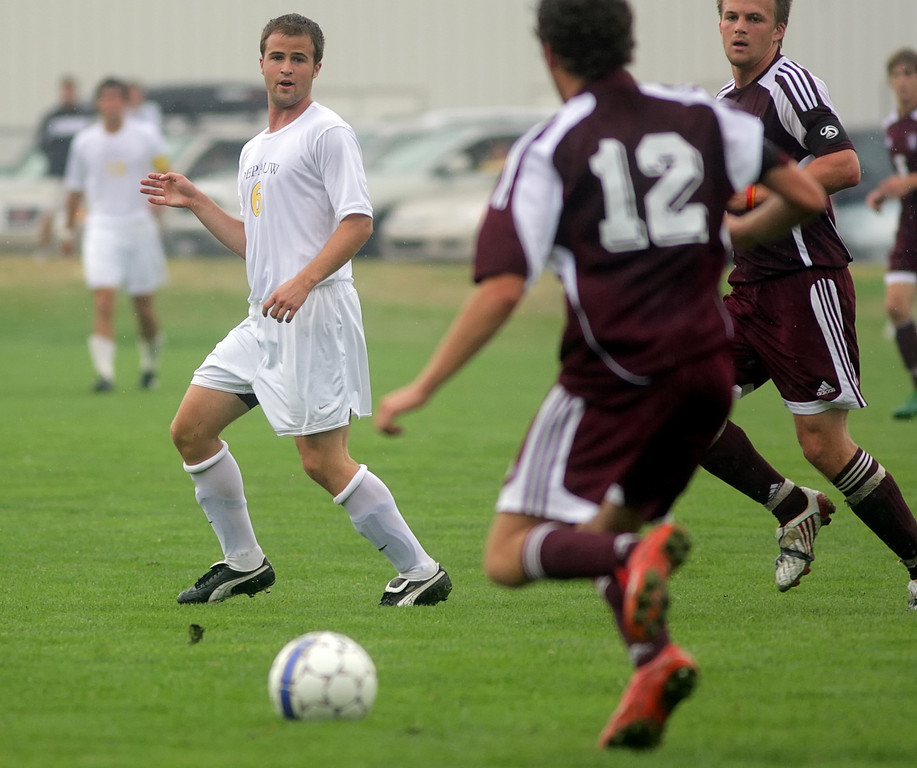 By Alex Turco/The DePauw--  Junior midfielder Stephen Keller watches the ball during DePauw's game against Alma, Sunday, Sept. 6, 2009. DePauw won a shut-out 3-0 victory.