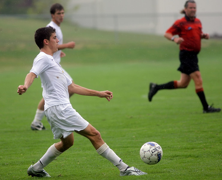 By Alex Turco/The DePauw--  Junior midfielder Danny Witzerman takes the ball downfield during DePauw's game against Alma, Sunday, Sept. 6, 2009. DePauw won a shut-out 3-0 victory.