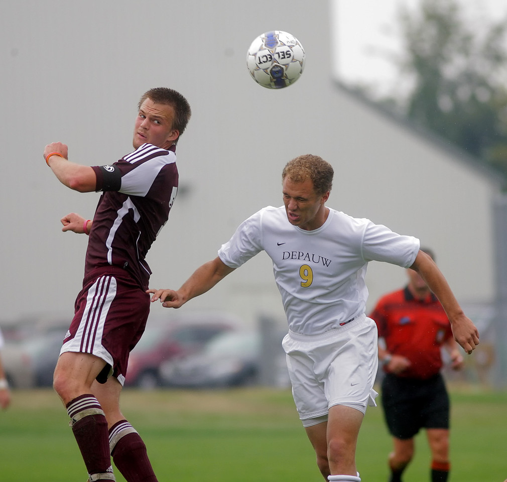 By Alex Turco/The DePauw--  Junior midfielder/forward Gary Pett fights to head the ball during DePauw's game against Alma, Sunday, Sept. 6, 2009. DePauw won a shut-out 3-0 victory.