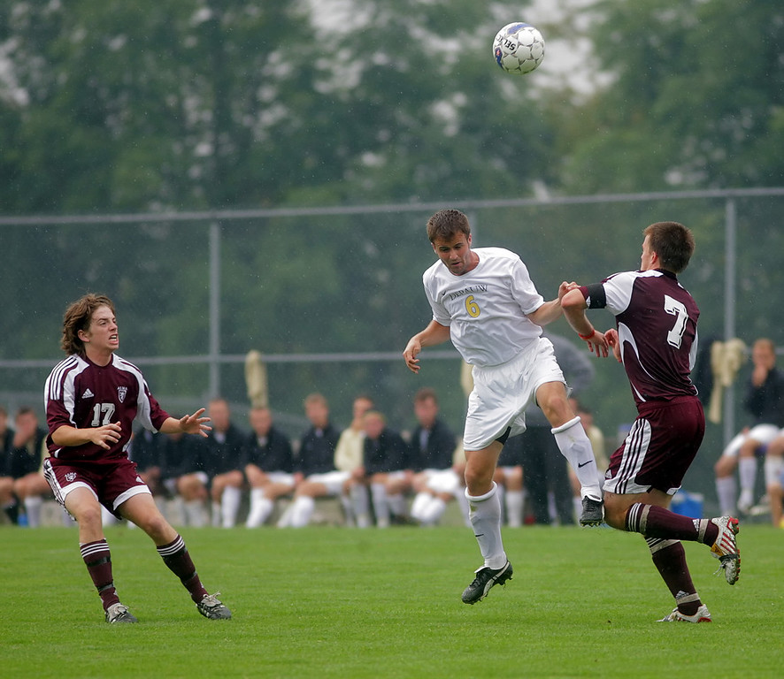 By Alex Turco/The DePauw--  Junior midfielder Stephen Keller jumps to head the ball during DePauw's game against Alma, Sunday, Sept. 6, 2009. DePauw won a shut-out 3-0 victory.