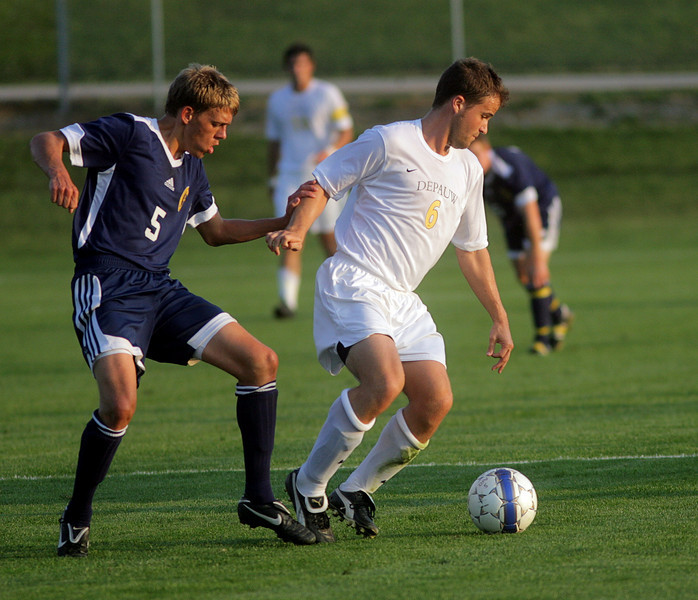 By Alex Turco/The DePauw--  Junior midfielder Stephen Keller fights off a defender during DePauw's game against Franklin College on Wednesday, Sept. 9, 2009 at Boswell Field.