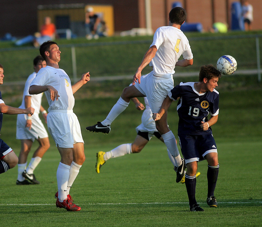 By Alex Turco/The DePauw--  Senior midfielder Brian Lawless and sophomore midfielder Kreigh Kamman jump for a ball during DePauw's game against Franklin College on Wednesday, Sept. 9, 2009 at Boswell Field.