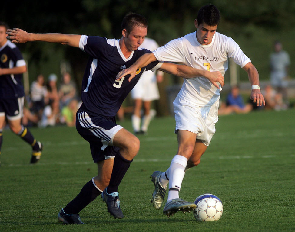 By Alex Turco/The DePauw--  Junior midfielder Danny Witzerman fights a defender for control of the ball during DePauw's game against Franklin College on Wednesday, Sept. 9, 2009 at Boswell Field.