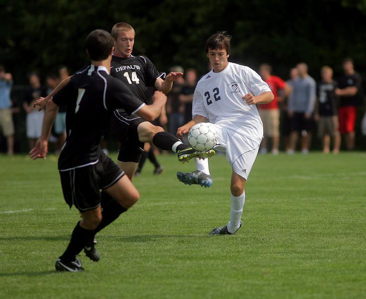 By Alex Turco--  Freshman midfielder Matt Schoenfeld kicks the ball downfield during DePauw's game against Elmhurst, Saturday, Sept. 5, 2009. DePauw won a shut-out 2-0 victory.