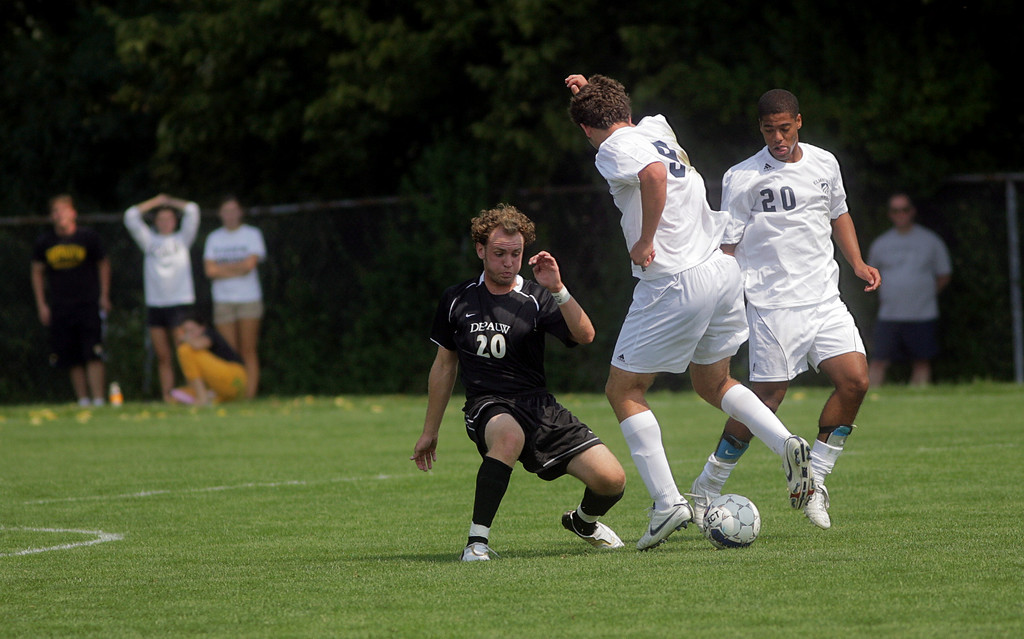 By Alex Turco--  Freshman back Chris Talian fights for the ball during DePauw's game against Elmhurst, Saturday, Sept. 5, 2009. DePauw won a shut-out 2-0 victory.