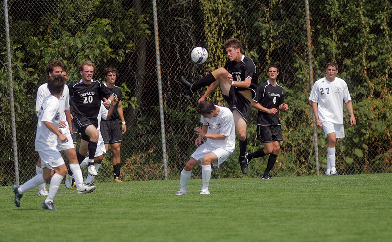 By Alex Turco--  Freshman forward Christopher Lee jumps for a kick during DePauw's game against Elmhurst, Saturday, Sept. 5, 2009. DePauw won a shut-out 2-0 victory.