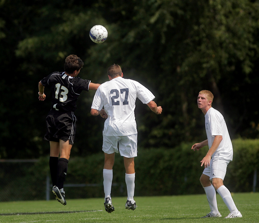 By Alex Turco--  Sophomore forward Derek O'Grady heads the ball during DePauw's game against Elmhurst, Saturday, Sept. 5, 2009. DePauw won a shut-out 2-0 victory.
