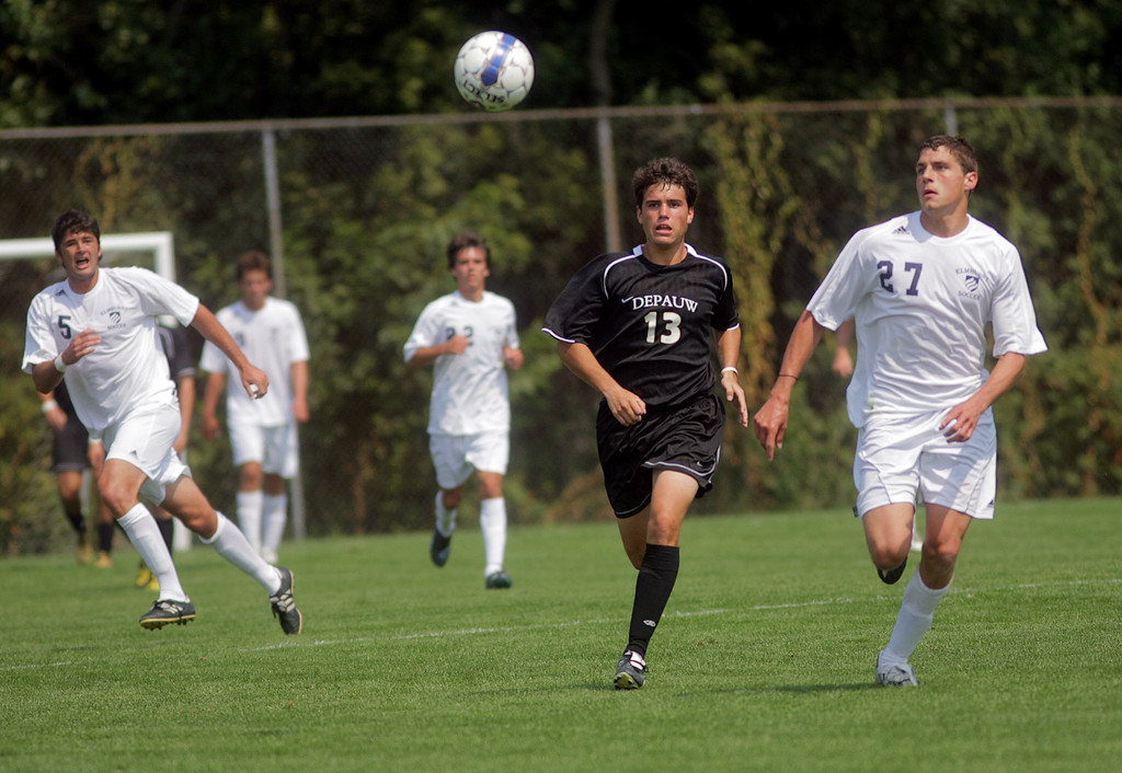 By Alex Turco--  Sophomore forward Derek O'Grady races an opposing player to the ball during DePauw's game against Elmhurst, Saturday, Sept. 5, 2009. DePauw won a shut-out 2-0 victory.
