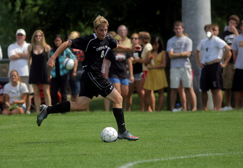 By Alex Turco--  Freshman forward Thomas Balcom moves the ball downfield during DePauw's game against Elmhurst, Saturday, Sept. 5, 2009. DePauw won a shut-out 2-0 victory.