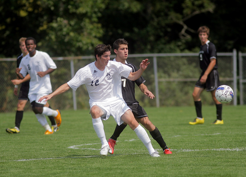 By Alex Turco--  Junior midfielder Danny Witzerman fights for the ball during DePauw's game against Elmhurst, Saturday, Sept. 5, 2009. DePauw won a shut-out 2-0 victory.