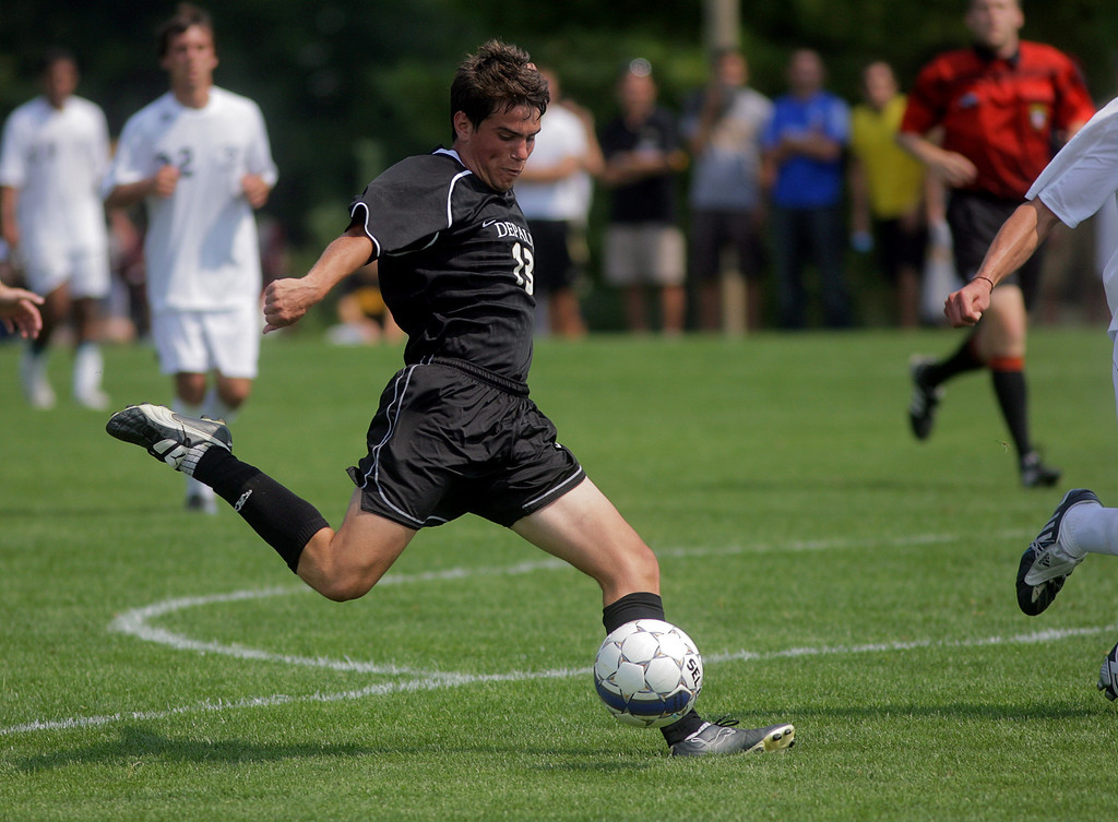 By Alex Turco--  Sophomore forward Derek O'Grady kicks the ball downfield during DePauw's game against Elmhurst, Saturday, Sept. 5, 2009. DePauw won a shut-out 2-0 victory.