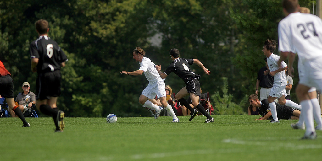 By Alex Turco--  Sophomore midfielder Kreigh Kamman chases the ball during DePauw's game against Elmhurst, Saturday, Sept. 5, 2009. DePauw won a shut-out 2-0 victory.