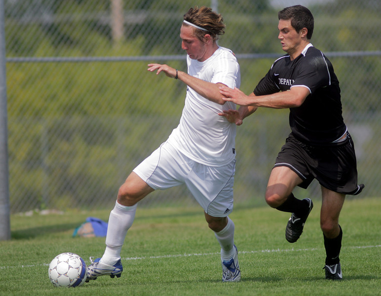 By Alex Turco--  Sophomore midfielder Kreigh Kamman chases the ball downfield during DePauw's game against Elmhurst, Saturday, Sept. 5, 2009. DePauw won a shut-out 2-0 victory.