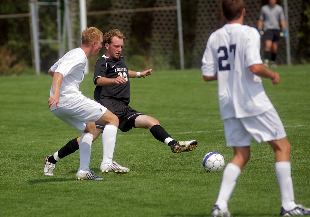 By Alex Turco--  Freshman back Chris Talian kicks the ball away from a defender during DePauw's game against Elmhurst, Saturday, Sept. 5, 2009. DePauw won a shut-out 2-0 victory.