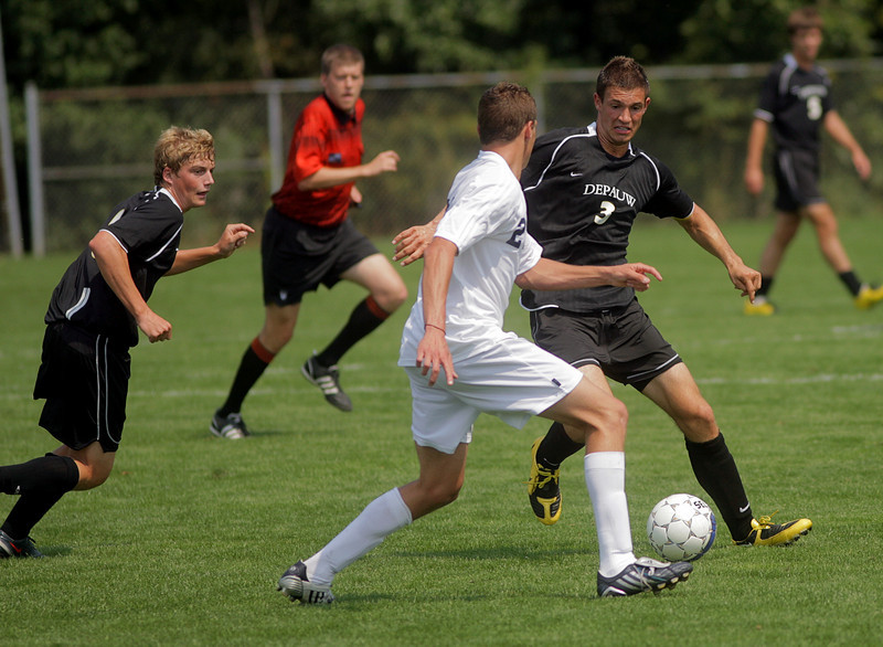 By Alex Turco--  Junior defender Josh Schlake fights a defender for possession during DePauw's game against Elmhurst, Saturday, Sept. 5, 2009. DePauw won a shut-out 2-0 victory.