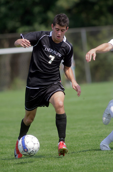 By Alex Turco--  Junior midfielder Danny Witzerman moves the ball downfield during DePauw's game against Elmhurst, Saturday, Sept. 5, 2009. DePauw won a shut-out 2-0 victory.