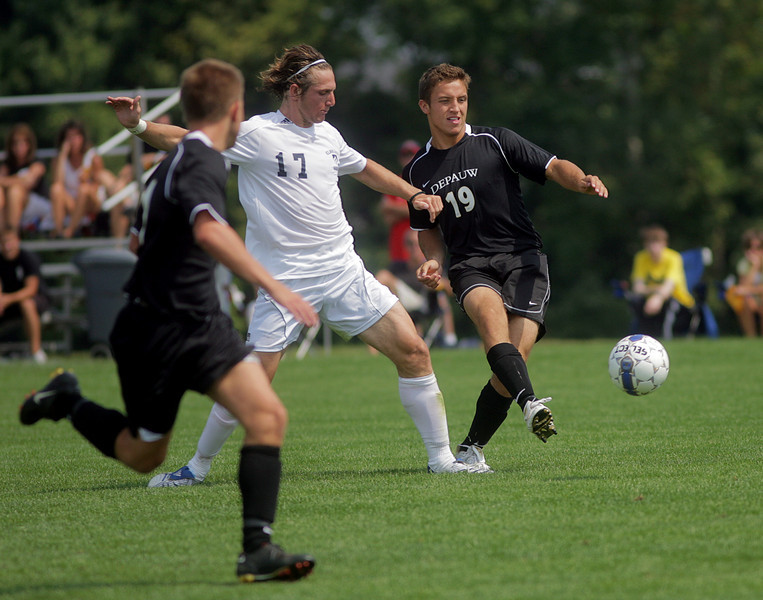 By Alex Turco-- Freshman forward Jent Botterman kicks the ball away from an opposing player during DePauw's game against Elmhurst, Saturday, Sept. 5, 2009. DePauw won a shut-out 2-0 victory.