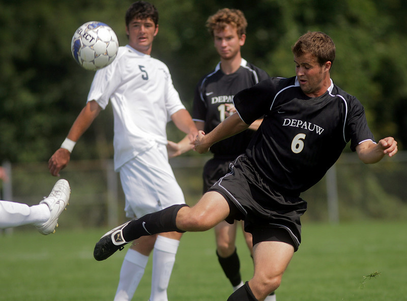 By Alex Turco--  Junior midfielder Stephen Keller fights for possession of the ball during DePauw's game against Elmhurst, Saturday, Sept. 5, 2009. DePauw won a shut-out 2-0 victory.