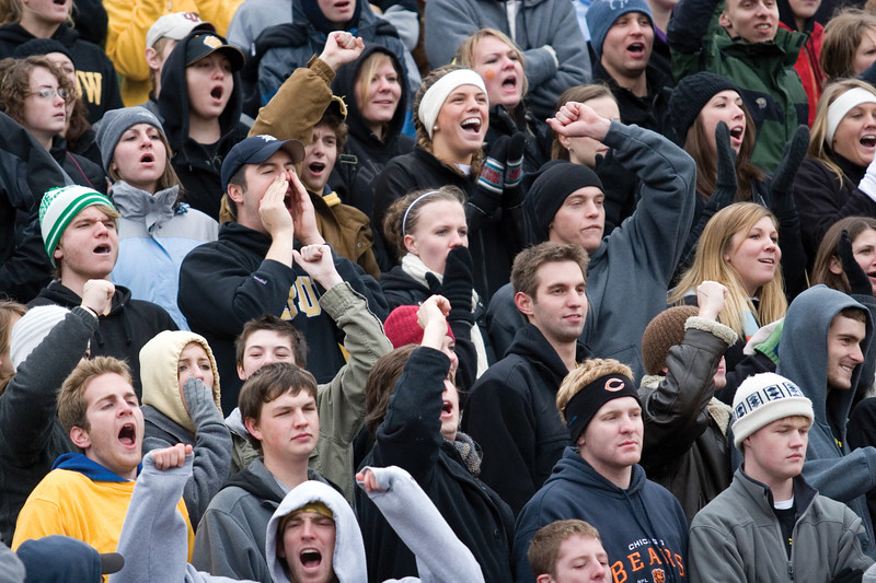 Cheering DePauw students crowd the stands during the game.  <br /> <br /> Photo by Alex Turco