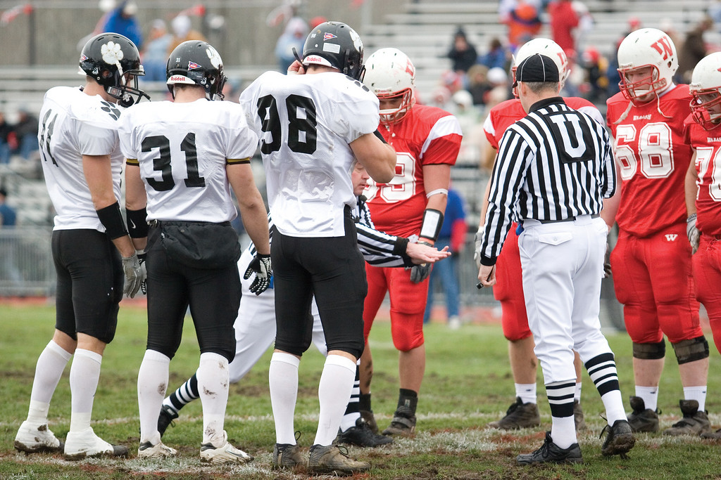 The DePauw team captains win the toss before the game. <br /> <br /> Photo by Alex Turco
