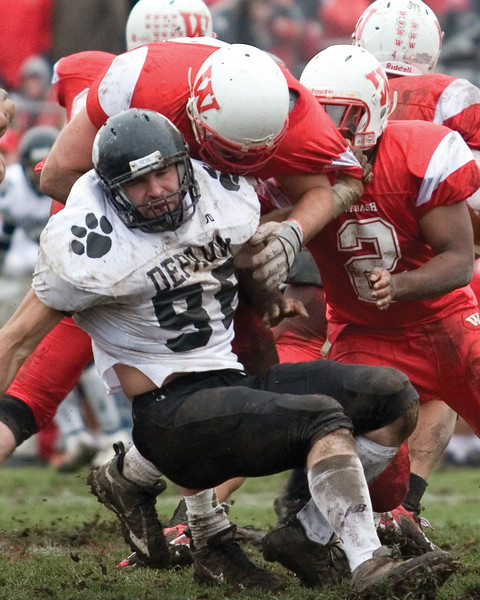 Wabash players tackle senior defensive lineman Dustin Hertel. <br /> <br /> Photo by Alex Turco