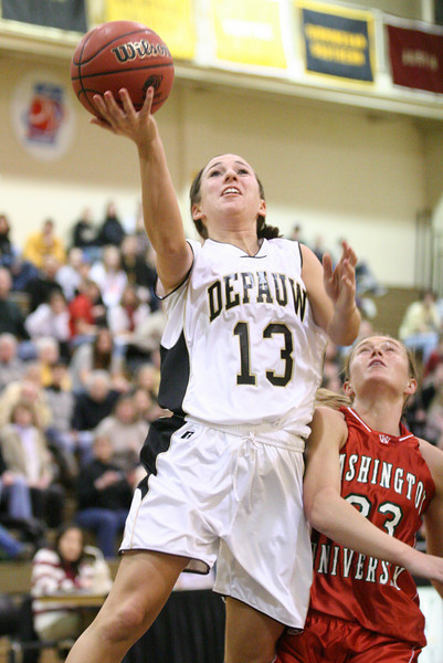 Junior guard Cassie Pruzin takes a shot over a Washington defender during DePauw's game against Washington University.  DePauw defeated Washington 73-66 in the second round of the NCAA D3 tournament March 8, 2008.  PHOTO BY ALEX TURCO