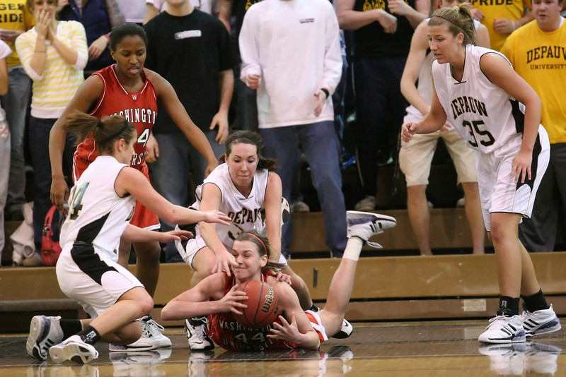 Sophomore forward Jenna Fernandez and senior guard Gretchen Haehl fight a Washington player for the ball as sophomore forward Emily Marshall look on during the DePauw women's basketball game against Washington University- St. Louis in the second round of the NCAA division three tournament, March 8, 2008.  The Tigers won 73-66, advancing to the NCAA Division III round of sixteen.  PHOTO BY ALEX TURCO