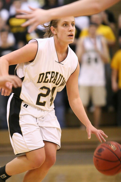 Senior guard Gretchen Haehl watches for an opening during the DePauw women's basketball game against Washington University- St. Louis in the second round of the NCAA division three tournament, March 8, 2008.  The Tigers won 73-66, advancing to the NCAA Division III round of sixteen.  PHOTO BY ALEX TURCO
