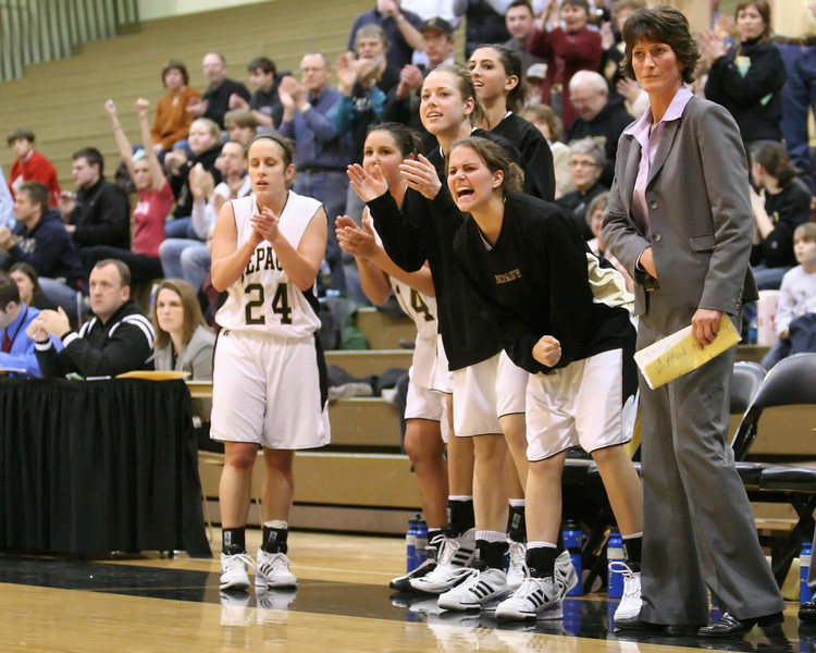 DePauw players and coach Kris Huffman watch and cheer from the bench during the second half of the DePauw women's basketball game against Washington University- St. Louis in the second round of the NCAA division three tournament, March 8, 2008.  The Tigers won 73-66, advancing to the NCAA Division III round of sixteen.  PHOTO BY ALEX TURCO