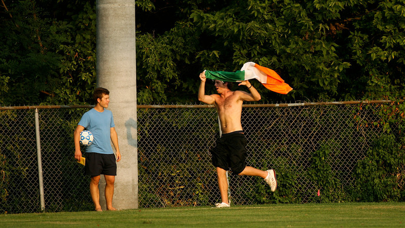 A fan cheers on the sidelines after senior forward Mike Harris scored on a penalty kick and put DePauw ahead 1-0 in the second half of their game against Holy Cross.  The Tigers went on to win 2-0 in the August 29 game at Bowman field. Photo by Alex Turco