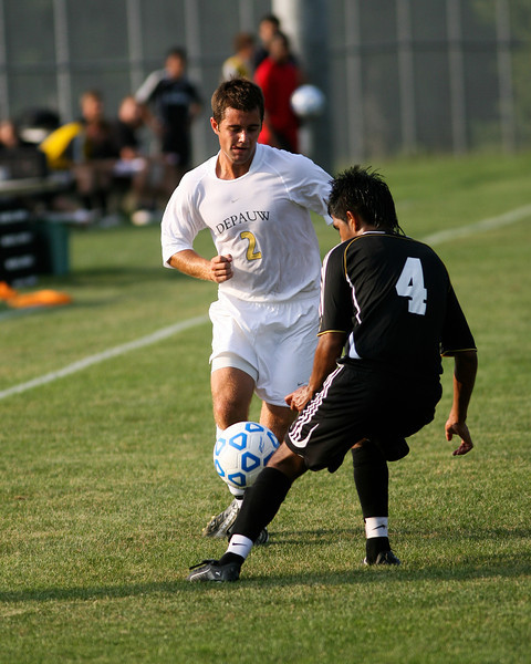Senior midfielder Kaes Kamman fights a defender for the ball  during DePauw's game against Holy Cross. The Tigers won 2-0 in the game August 29, 2008, at Bowman Field. Photo by Alex Turco