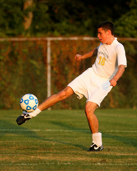 Freshman midfielder Matt Brown makes a kick  during DePauw's game against Holy Cross. The Tigers won 2-0 in the game August 29, 2008, at Bowman Field. Photo by Alex Turco