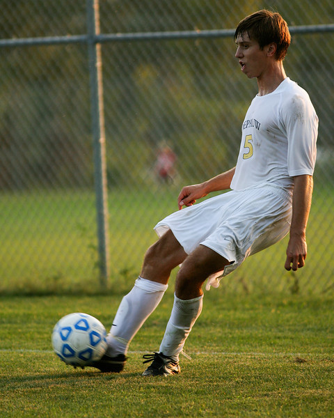 Sophomore back Alex Johnson kicks the ball into play during DePauw's game against Holy Cross. The Tigers won 2-0 in the game August 29, 2008, at Bowman Field. Photo by Alex Turco