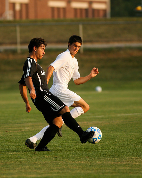 Freshman midfielder Kreigh Kamman fights a defender for the ball  during DePauw's game against Holy Cross. The Tigers won 2-0 in the game August 29, 2008, at Bowman Field. Photo by Alex Turco