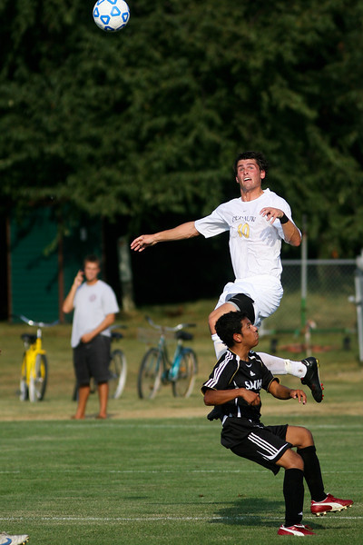 Junior midfielder Beau Sorg reacts to a header during DePauw's game against Holy Cross. The Tigers won 2-0 in the game August 29, 2008, at Bowman Field. Photo by Alex Turco