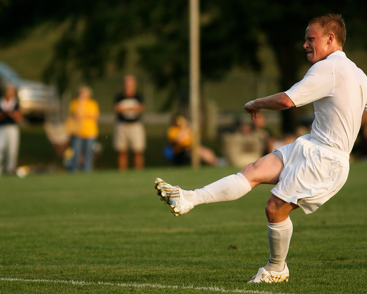 Senior forward Mike Harris shoots a penalty shot early in the second half of DePauw's game against Holy Cross.  The shot scored, putting DePauw ahead 1-0, the first of two unanswered goals during the August 29, 2008 game at Bowman Field. Photo by Alex Turco