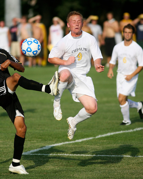 Senior forward Mike Harris reacts as he kicks the ball and is hit in the knee by a defender's cleat  during DePauw's game against Holy Cross. The Tigers won 2-0 in the game August 29, 2008, at Bowman Field. Photo by Alex Turco