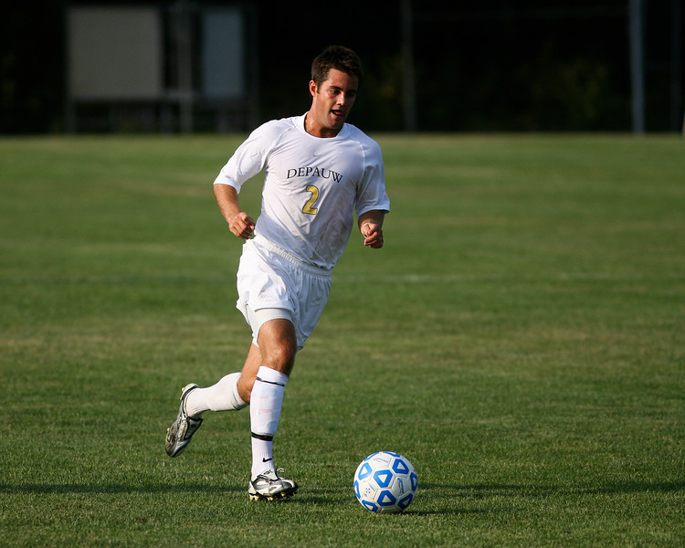 Senior midfielder Kaes Kamman moves the ball down field  during DePauw's game against Holy Cross. The Tigers won 2-0 in the game August 29, 2008, at Bowman Field.