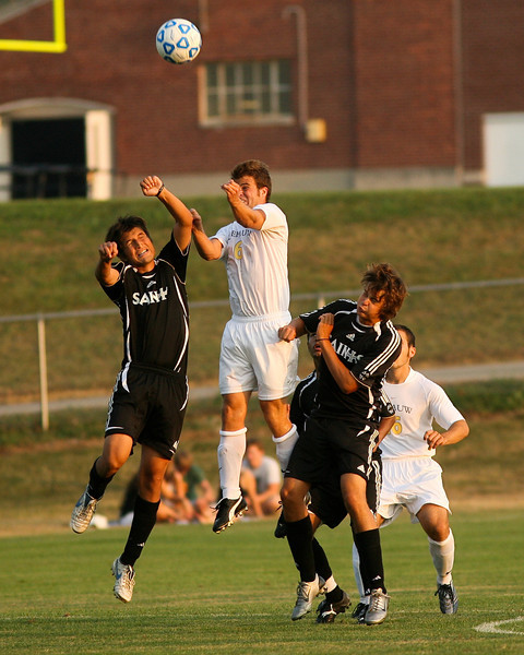 Sophomore midfielder Stephen Keller jumps for a header during DePauw's game against Holy Cross. The Tigers won 2-0 in the game August 29, 2008, at Bowman Field. Photo by Alex Turco