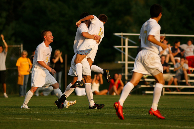 Junior midfielder Beau Sorg lifts sophomore midfielder Brad Kean into the air after the latter scored DePauw's second unanswered goal in the second half of their game against Holy Cross August 29, 2008 at Bowman field.  The Tigers went on to win 2-0.  Photo by Alex Turco